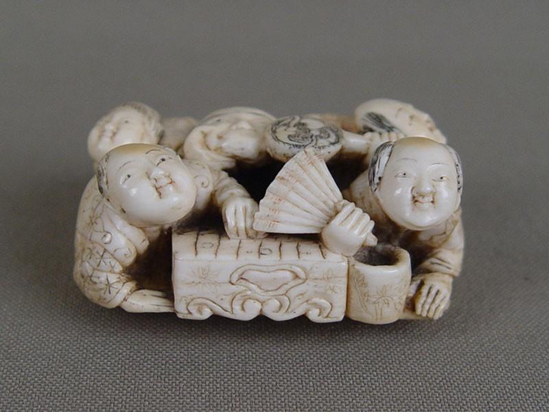 Нэцкэ «Праздник Масок», кость, резьба. Япония, XIXвек, длина— 5см