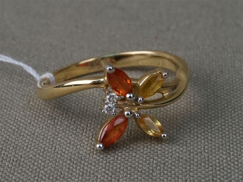 Кольцо, золото 585 пробы, общий вес 2,39г. Вставки: бриллианты (2бр Кр57 – 0,016ct 3/5); 4 желтых и оранжевых сапфира. Размер кольца 17