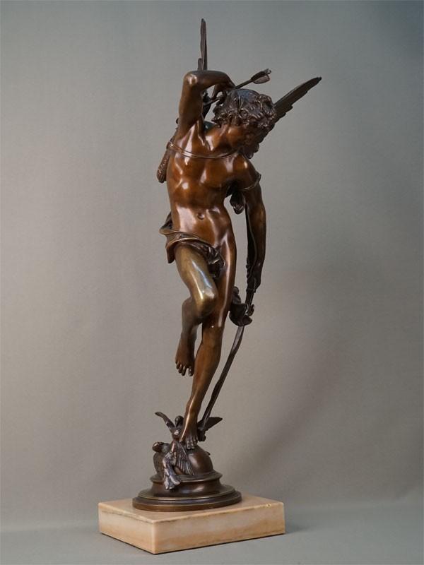 «Стоящий Амур», бронза, литье, чеканка, патинирование; постамент мрамор, высота 70см. Франция, Париж, вторая половина 1870-х – начало 1880-х годов, скульптор Жюль-Феликс Кутан (1848-1939).