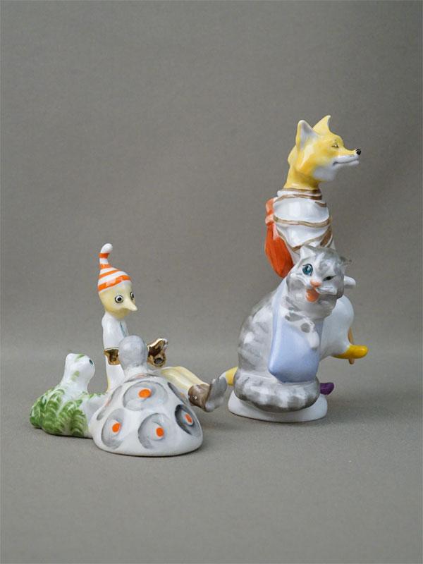 Две скульптуры «Буратино и Черепаха Тортилла» (ЛФЗ) и «Кот Базилио и Лиса Алиса» (без марки), фарфор, роспись, золочение, высота 8см и 15см