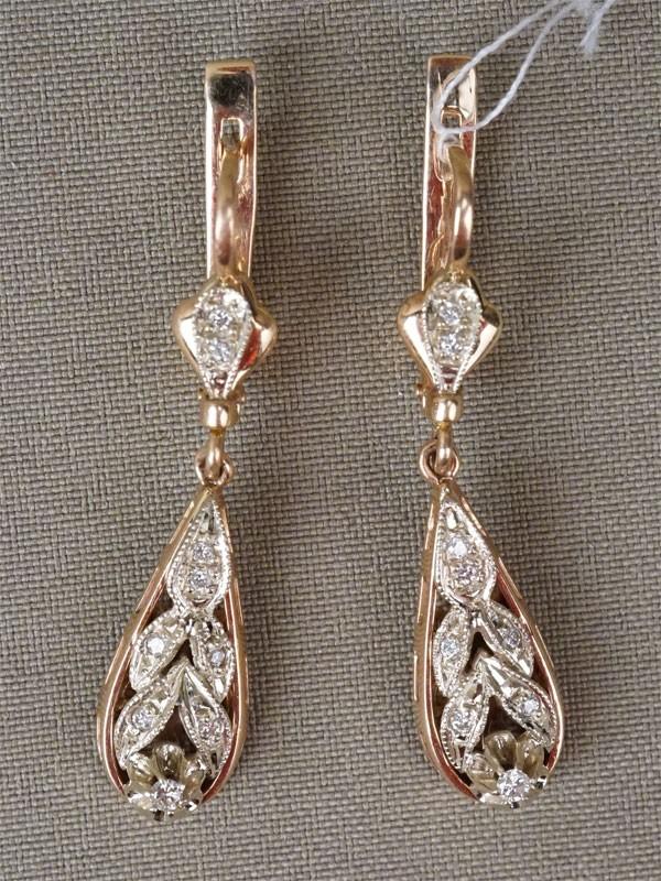 Серьги, золото 585 пробы, общий вес 9,38г. Вставки: бриллианты (18бр Кр57 – 0,26ct 3-4/3-4)